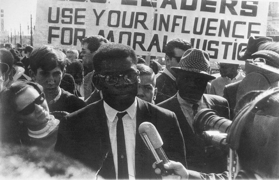 (photo courtesy The Daily Utah Chronicle) John Driver, the head of the Salt Lake City chapter of the NAACP, leads a prayer march outside LDS Church headquarters in 1965.