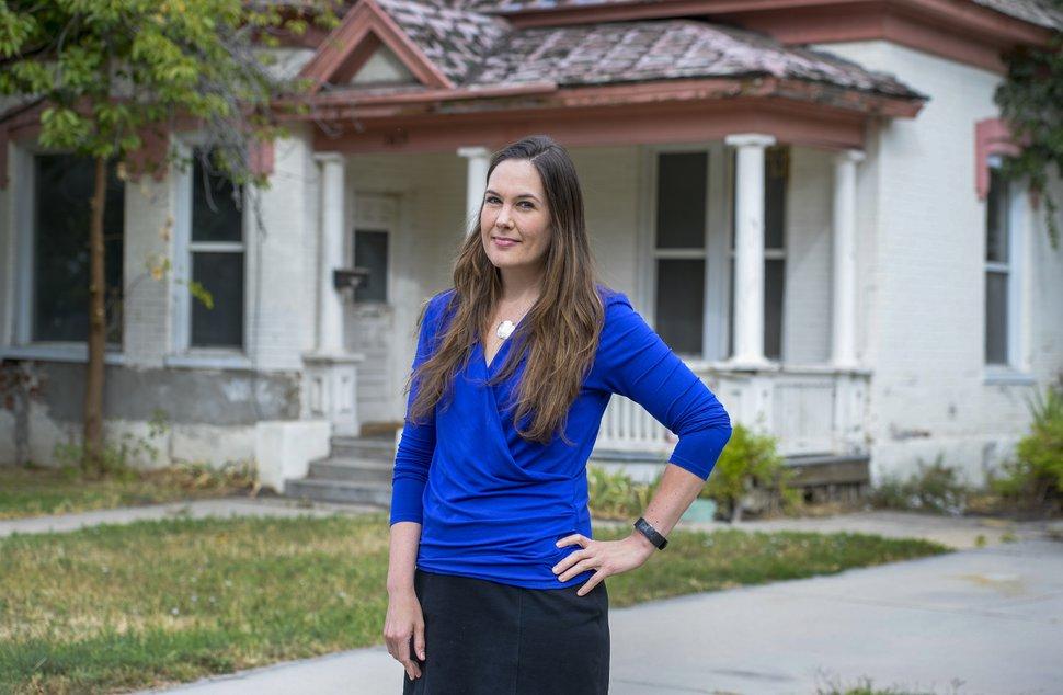 (Leah Hogsten | The Salt Lake Tribune) Ballpark Community Council Chairwoman Amy Hawkins cleaned out the backyard of a boarded up home located at Richards Street after she was alerted to criminal activity and squatters living on the property. Hawkins and her neighbors in the Ballpark area are concerned about the impact of boarded properties and crimes occurring in the community.