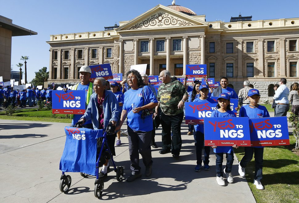 (Ross D. Franklin | The Associated Press) A coalition of groups march during a rally to build support for extending the life of the Navajo Generating Station power plant near the Arizona-Utah border, in front of the Arizona Capitol Tuesday, Feb. 6, 2018, in Phoenix.