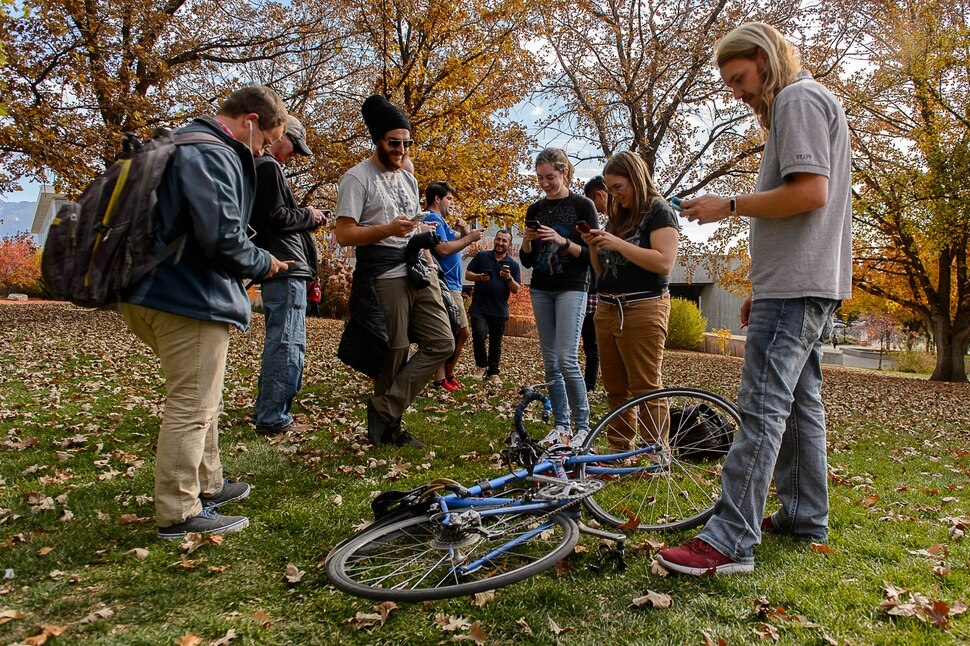(Trent Nelson | The Salt Lake Tribune) A group of Pokemon Go players participate in a raid at the University of Utah in Salt Lake City on Thursday, Oct. 19, 2017.