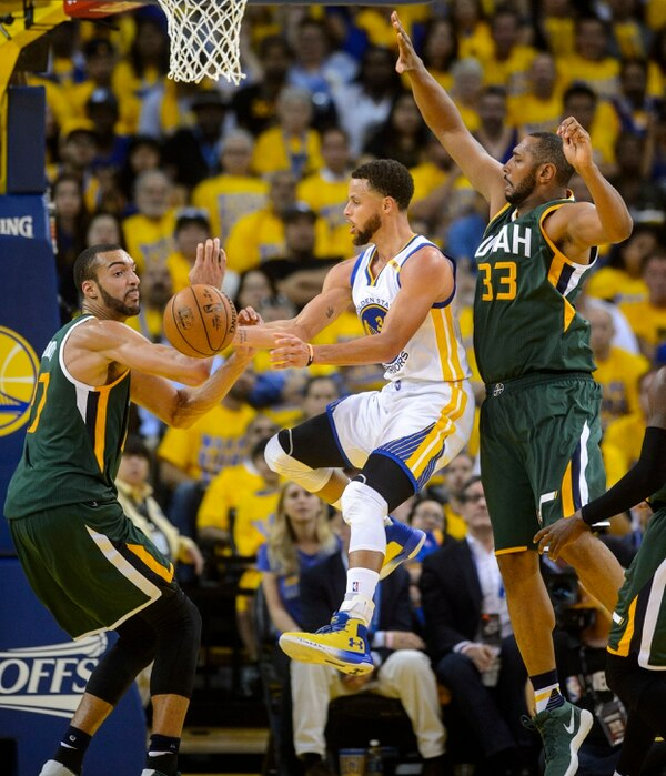 Steve Griffin | The Salt Lake Tribune Golden State Warriors guard Stephen Curry (30) passes away from the Utah Jazz center Rudy Gobert (27) and Utah Jazz center Boris Diaw (33) during NBA playoff game between the Utah Jazz and the Golden State Warriors at Oracle Arena in Oakland Tuesday May 2, 2017.