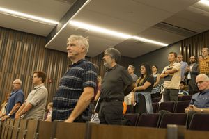 (Rick Egan  |  The Salt Lake Tribune)  Members of the University of Utah Academic Senate stand to approve an amendment, after discussing the $10 million donation from the Charles Koch Foundation. Monday, Aug. 28, 2017.