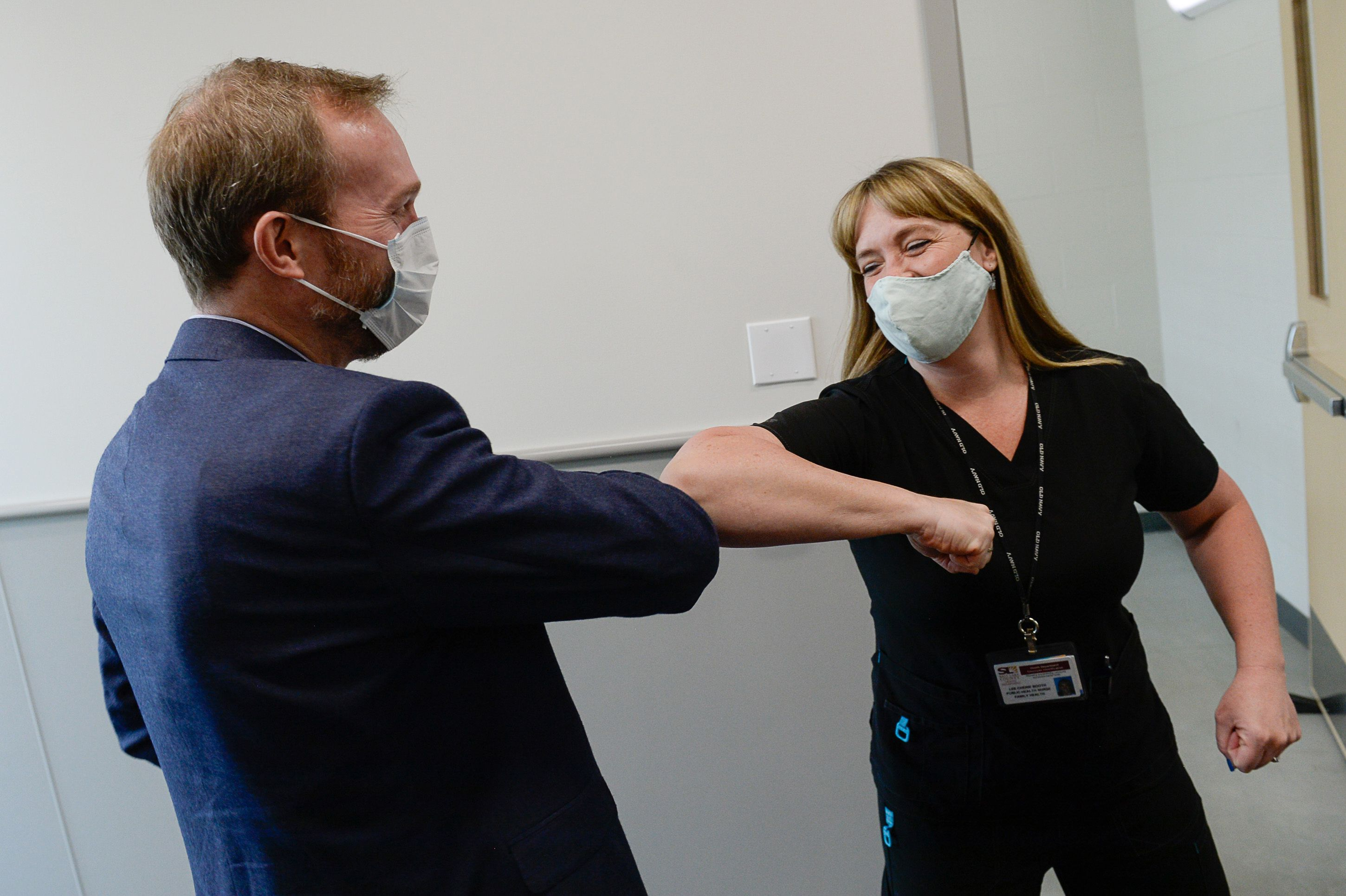 (Francisco Kjolseth     The Salt Lake Tribune) Congressman Ben McAdams, D-Utah, greets public health nurse Lee Cherie Booth at the Salt Lake County Public Health Center on Tuesday, April 28, 2020, where he thanked employees who are producing vital data about the source of the county's COVID-19 infections and how it may have spread among county residents.