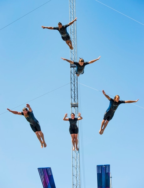 (Rick Egan | The Salt Lake Tribune) Five divers from the Flying Fools High Dive show, dive into a 10-foot pool of water at the same time, on opening day of the Utah State Fair, Thursday, Sept. 6, 2018.