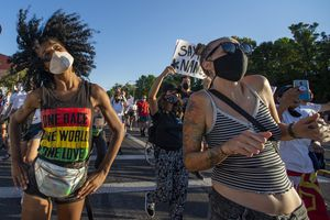 (Rick Egan     The Salt Lake Tribune)     Kayla McKay and Kayla Janae Dixon dance in the streets of Salt Lake City, during the Dance Dance For Revolution protest for racial equality, on Sunday, Aug. 9, 2020.