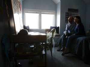 (Leah Hogsten  |  The Salt Lake Tribune) Tiffany James and Aaron James reflect on the life of their late son, Zane James as they sit in his bedroom, Dec. 28, 2018. Zane James, who was suspected of two armed robberies, was shot and killed by Cottonwood Heights police in May 2018. The family filed an amended lawsuit Aug. 5, 2021, alleging the police department tried to cover up what happened.