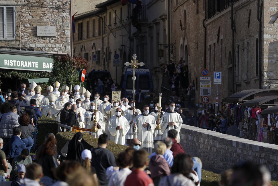 (Gregorio Borgia | AP) A procession walks through the streets of Assisi, Italy, prior to the beatification ceremony of 15-year-old Carlo Acutis, an Italian boy who died in 2006 of leukemia, Saturday, Oct. 10, 2020.