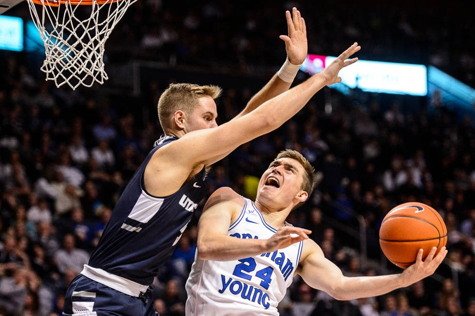 (Trent Nelson | The Salt Lake Tribune) Brigham Young Cougars guard McKay Cannon (24) shoots, defended by Utah State Aggies guard Sam Merrill (5) as BYU hosts Utah State, NCAA basketball in Provo on Wednesday Dec. 5, 2018.