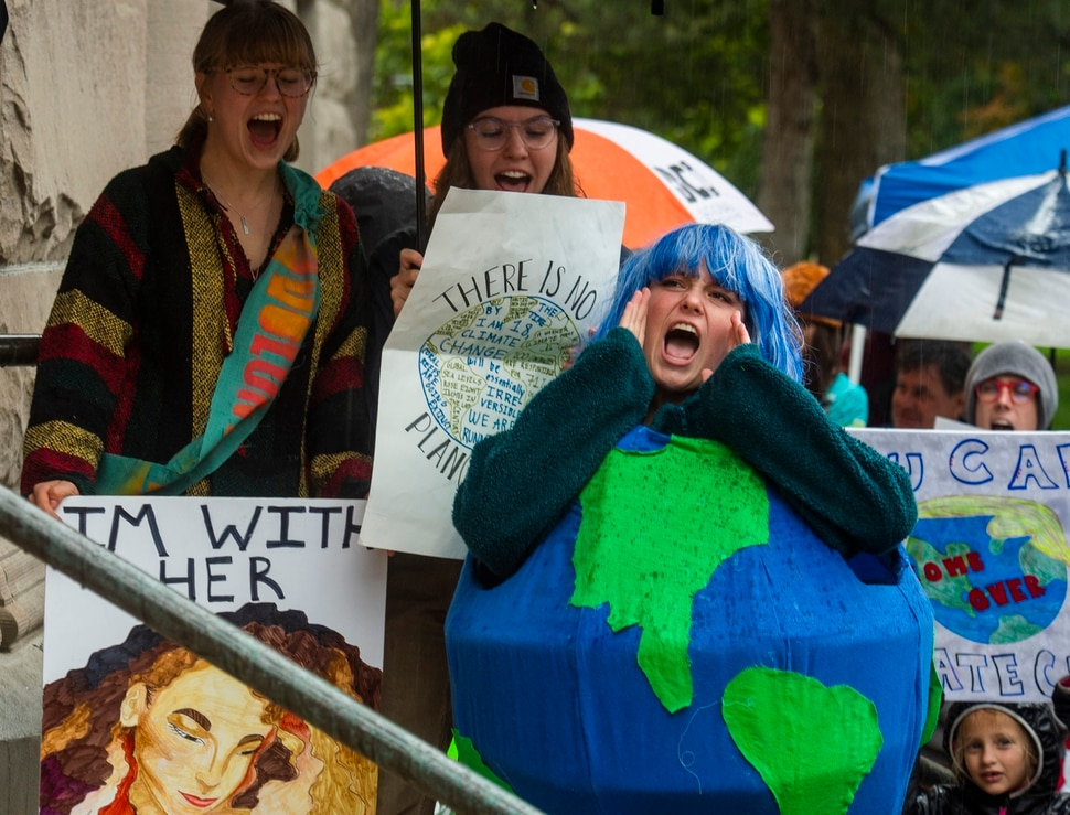 (Rick Egan | The Salt Lake Tribune) Alee Lawlor, from Ames High School wears a costume shaped like the earth as she chants along with the crowd outside Salt Lake City Hall at the Utah Youth Climate Strike. Hundreds of young people from around the state gathered at the City Building, then marched to the Utah State Capitol, demanding action on the climate crisis. Friday, Sept. 20, 2019.