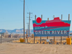 (Murice Miller | Special to The Salt Lake Tribune)  The welcome sign for Green River, Utah, on Nov. 25, 2020. Nearly 9,000 acres of private, state and federal land just west of Green River has been proposed as the site of a satellite inland port, which proponents say would attract warehouse, shipping and manufacturing facilities to Emery and Carbon counties.