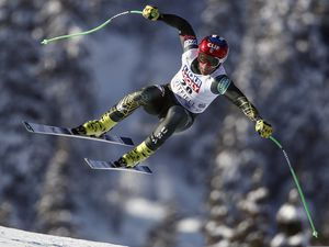 United States' Steven Nyman is airborne as he speeds down the course during an alpine ski, men's World Cup downhill, in Kvitfjell, Norway, Saturday, March 7, 2020. Nyman, of Sundance, will be the eldest member of the U.S. Alpine Ski Team this year, followed closely by Park City's Ted Ligety. (AP Photo/Gabriele Facciotti)