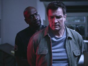 "(Photo courtesy of ABC) Sgt. Grey (Richard T. Jones) takes Officer Nolan (Nathan Fillion) into custody in the Season 3 premiere of ""The Rookie."""