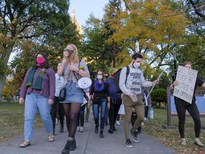 (Leah Hogsten | Tribune file photo) UnsafeU members Devon Cantwell, left, and Rebecca Hardenbrook, next, lead a march on Oct. 20, 2020, in Salt Lake City against the police at the University of Utah in this file photo. Cantwell and Hardenbrook are now part of a legislative effort pushing for a commission of students to review and recommend policy changes for campus safety in the state.