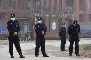 (AP Photo/Ng Han Guan) Security personnel near the entrance of the Wuhan Institute of Virology during a visit by the World Health Organization team in Wuhan in China's Hubei province on Wednesday, Feb. 3, 2021. A new report casts doubt on the theory that the COVID-19 virus originated at the Wuhan lab.