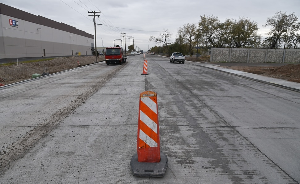 (Francisco Kjolseth | The Salt Lake Tribune) Salt Lake City officials have marked the completion of the Gladiola Street reconstruction project at 3400 West, which began in June, and was a complete rebuild of the roadway between 500 South and 900 South. The project, including wider lanes, improved curb and gutters, sidewalk enhancements, new ADA ramps, and bikes lanes is wrapping up after a City investment of $3 million dollars with plans to reconstruct another segment between 900 South and California Avenue in the next few years.