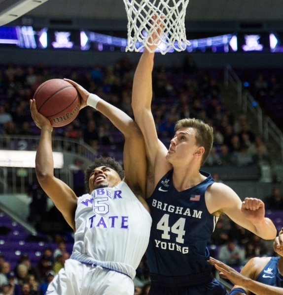 (Rick Egan | The Salt Lake Tribune) Weber State Wildcats guard Cody John (5) takes the ball to the hoop, as Brigham Young Cougars guard Connor Harding (44) defends, in basketball action between Brigham Young Cougars and Weber State Wildcats, at the Dee Event Center in Ogden, Saturday, Dec. 1, 2018.