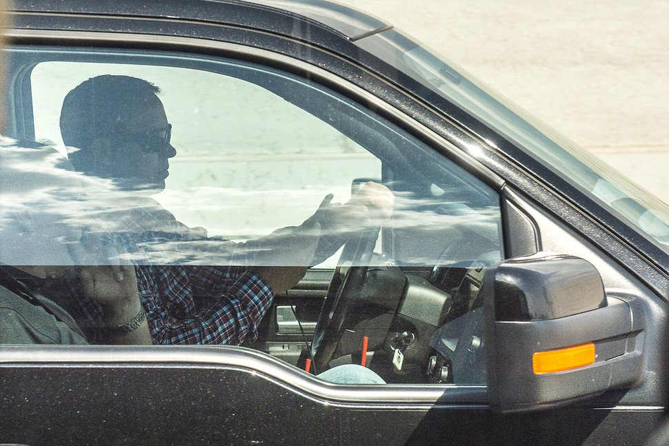 Chris Detrick   The Salt Lake Tribune A driver uses his cellphone while driving on Interstate 15 Thursday, July 13, 2017.