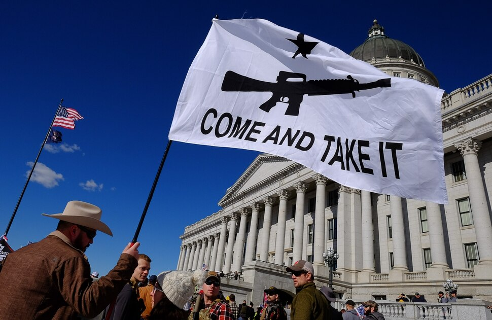 (Francisco Kjolseth | The Salt Lake Tribune) Cade Lightfoot, left, of Toole joins hundreds of pro gun proponents gathered at the Utah Capitol in Salt Lake City on Saturday, Feb. 8, 2020, in response to recent proposals from legislators, including red-flag laws, universal background checks and the elimination of private transfers.
