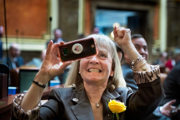 Scott Sommerdorf | The Salt Lake Tribune Rep. Christine F Watkins, R-Price, gleefully cheers and takes a photo of the vote totals for Rep. Rebecca Edwards resolution, SCR001 as it passed on the House floor, Wednesday, February, 14, 2018. The resolution proposes replacing a statue of Philo T. Farnsworth in the US Capitol with one of Martha Hughes Cannon.