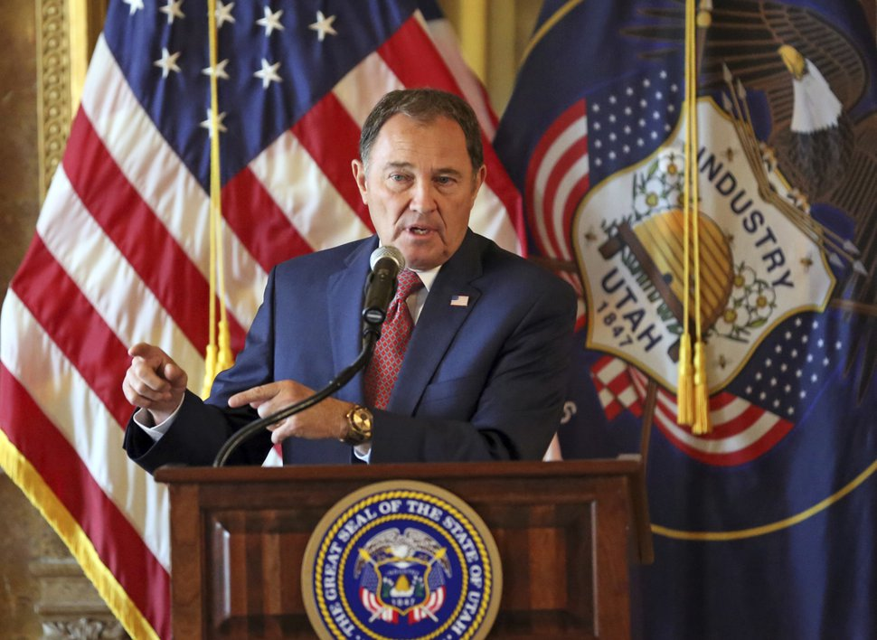 FILE - In this Sept. 12, 2018, file photo, Utah Gov. Gary Herbert speaks during a news conference at the Utah State Capitol, in Salt Lake City. Utah governor Gary Herbert has signed a sweeping overhaul of the state's tax system that lowers income tax while increasing taxes on food, fuel and several services. The Salt Lake Tribune reports Herbert defended the bill that cuts taxes by a net total of $160 million during his monthly news conference at PBS Utah. (AP Photo/Rick Bowmer, File)