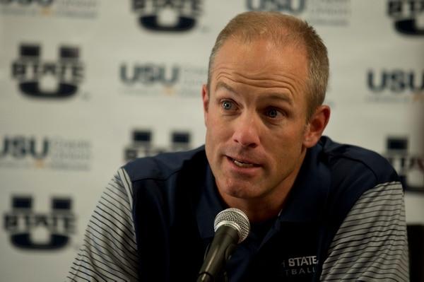(Lennie Mahler | Tribune file photo) Utah State University head football coach Matt Wells answers questions during media day in Logan, Utah, Thursday, Aug. 4, 2016.