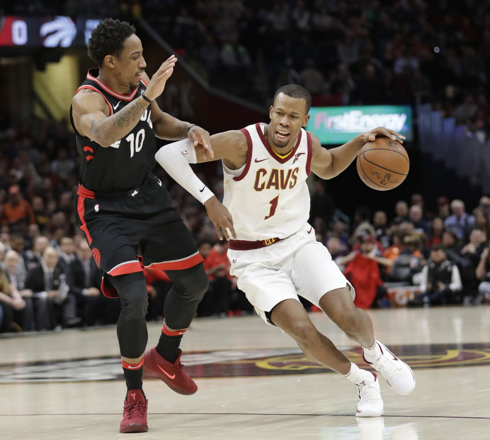 Cleveland's Rodney Hood (1) drives past Toronto's DeMar DeRozan (10) during a game earlier this season. (AP Photo/Tony Dejak, File)