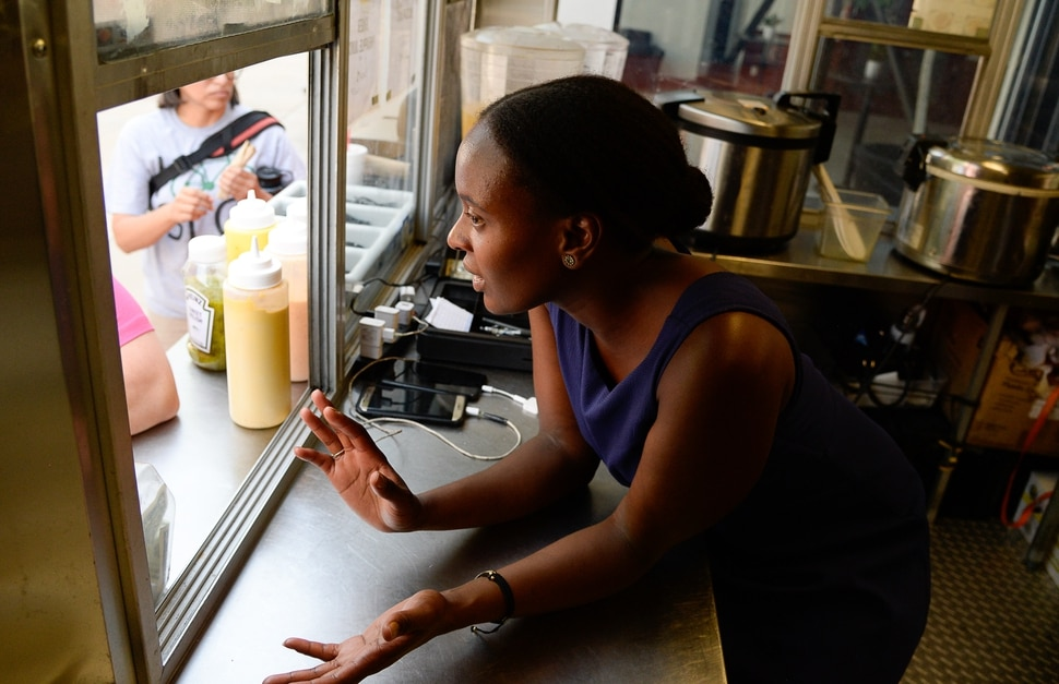 (Francisco Kjolseth | The Salt Lake Tribune) Joelle Twahirwa, owner of the Balabe Senegalese food truck takes orders from customers during Trolley Square Food Truck Night on Wednesday July 17, 2019. Three of the vendors that showed up, along with four others, will vie for the title of Best New Food Truck on Aug. 3 at the Food Truck and Brewery Battle at The Gateway.