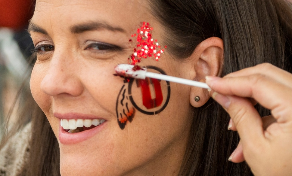 (Rick Egan | The Salt Lake Tribune) Amy Pederson, from Phoenix, has her face painted before the Alamo Bowl between the Utah Utes and the Texas Longhorns in San Antonio, Tuesday, Dec. 31, 2019.