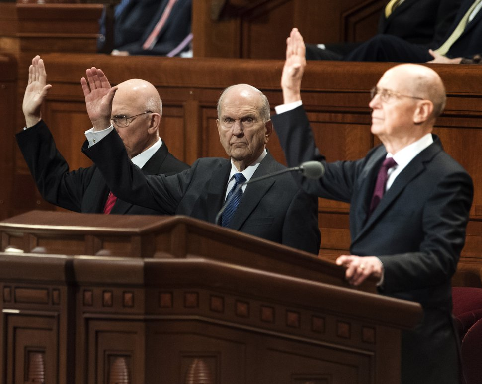 (Rick Egan | Tribune file photo) Members of the First Presidency raise their hands as they sustain President Russell M. Nelson during a Solemn Assembly in the Saturday morning session of the 188th Annual General Conference in Salt Lake City, Friday, March 30, 2018.