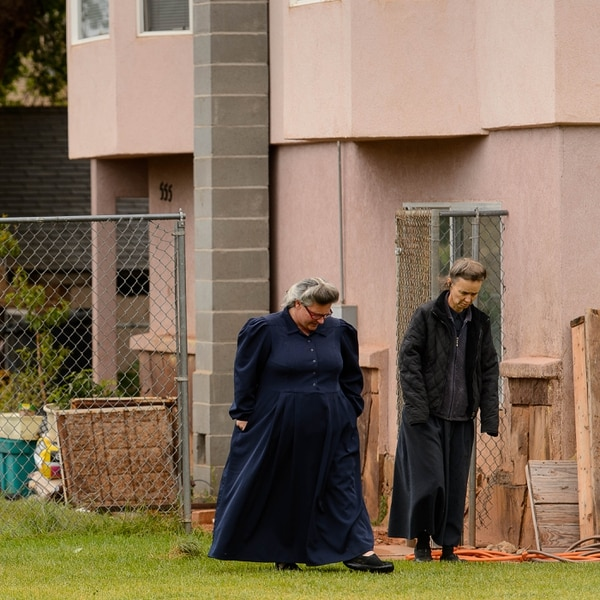Trent Nelson   The Salt Lake Tribune FLDS members Shannon Darger and Liz (last name unknown) walk away from their Colorado City, AZ, home after being evicted by the UEP Trust Wednesday May 10, 2017. Like other FLDS members, the two women consider working with the UEP Trust to be against their religious beliefs and would not sign an occupancy agreement with the trust.