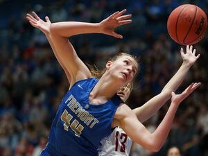 (Trent Nelson  |  The Salt Lake Tribune) Fremont's Maggie Mendelson reaches for a loose ball while facing Herriman in the 6A girls basketball state championship game, in Taylorsville on Saturday, March 6, 2021.
