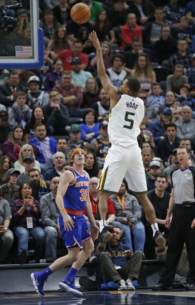 Utah Jazz guard Rodney Hood (5) shoots as New York Knicks guard Ron Baker (31) watches during the first half of an NBA basketball game Friday, Jan. 19, 2018, in Salt Lake City. (AP Photo/Rick Bowmer)