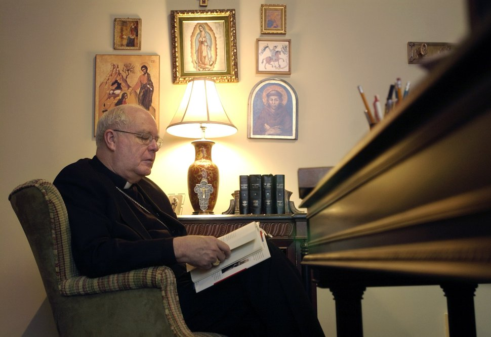 Al Hartmann | The Salt Lake Tribune Bishop George Niederauer in his office at the Catholic Diocese takes in a quiet moment to read. He has written a a book,