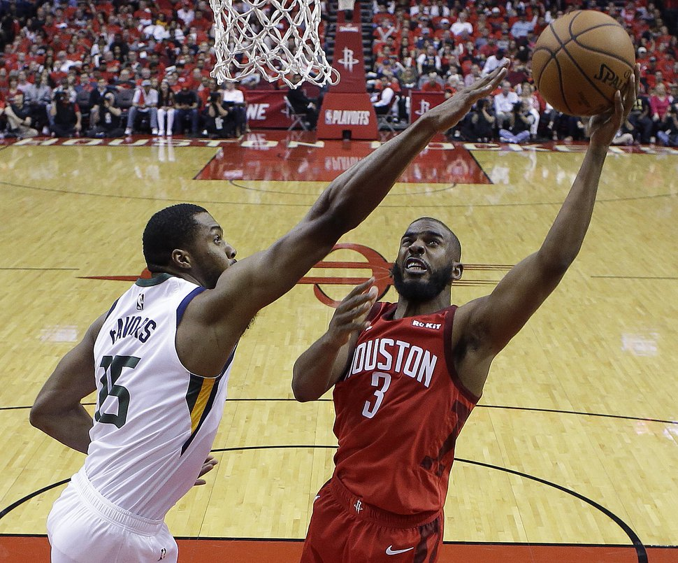 Houston Rockets guard Chris Paul (3) shoots as Utah Jazz forward Derrick Favors defends during the second half of Game 1 of an NBA basketball first-round playoff series, Sunday, April 14, 2019, in Houston. Houston won the game 122-90. (AP Photo/Eric Christian Smith)