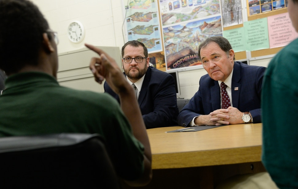 (Francisco Kjolseth | The Salt Lake Tribune) Juvenile Justice Services Director Brett Peterson, at Decker Youth Center in West Valley City, center left, is joined by Gov. Gary Herbert as they speak with some of the youth working through the program on Wednesday, Jan. 15, 2020, during a tour to discuss its success after juvenile justice reforms were passed in 2017.
