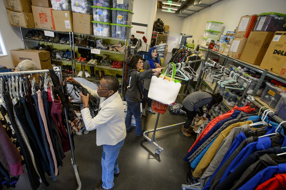 (Steve Griffin | The Salt Lake Tribune) Volunteers at Volunteers of America sort clothing that has been donated to help homeless young people in Salt Lake City Monday December 11, 2017.