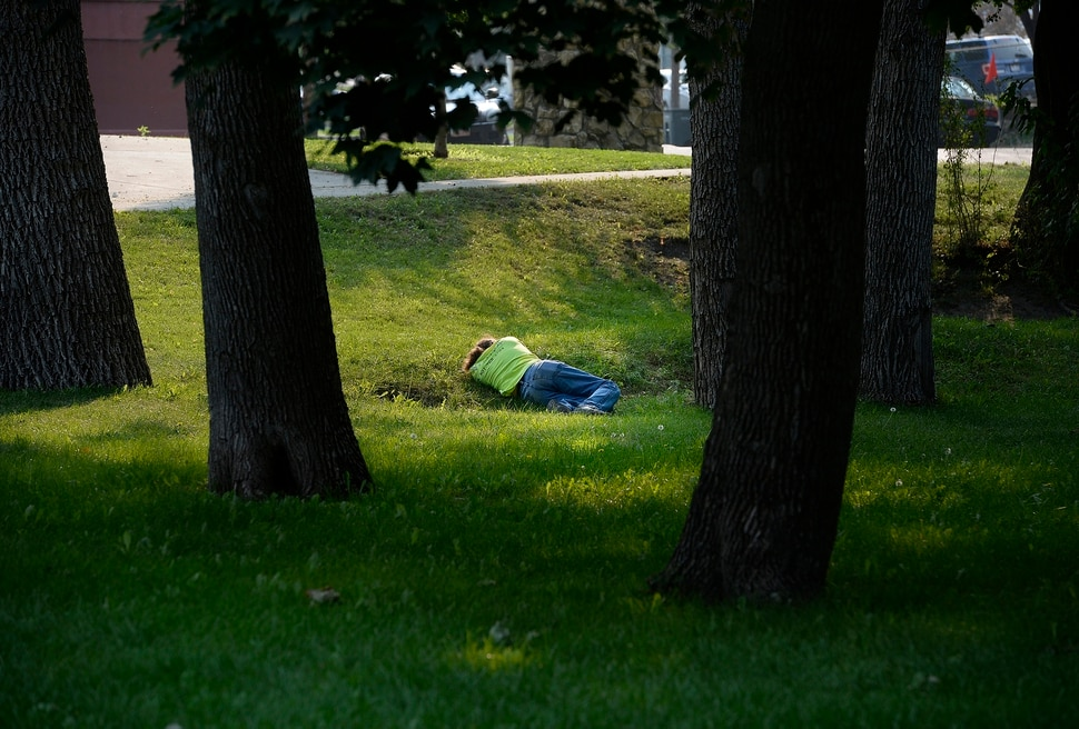 (Scott Sommerdorf | The Salt Lake Tribune) A man lays alone on the grass in Fairmont Park, Wednesday, September 6, 2017.