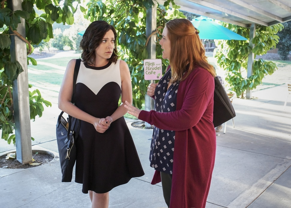 "(Courtesy of Tyler Golden/The CW) Rebecca (Rachel Bloom) gets help from Paula (Donna Lynne Champlin) as she plots revenge in ""Crazy Ex-Girlfriend."""