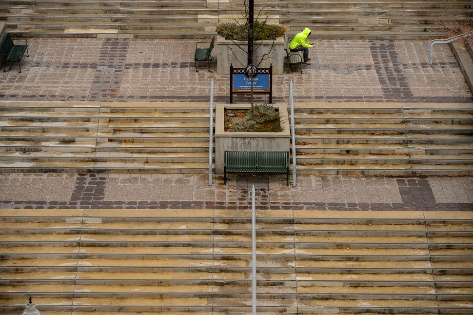 (Trent Nelson | The Salt Lake Tribune) A man looks at his phone in an empty Gallivan Center in Salt Lake City on Monday, March 23, 2020.