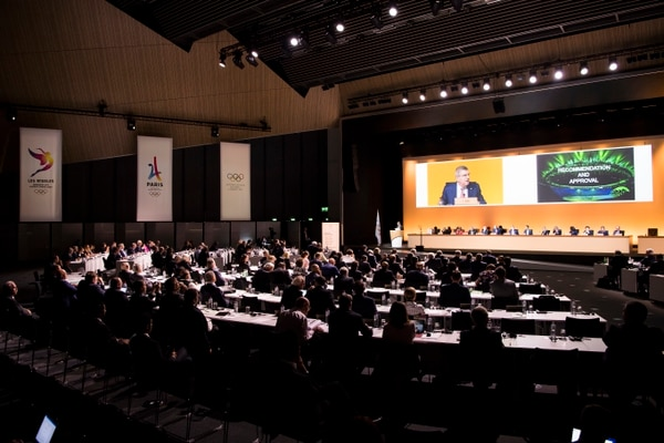 A general view shows International Olympic Committee, IOC, President Thomas Bach, from Germany on a giant screen during the International Olympic Committee (IOC) Extraordinary Session, at the SwissTech Convention Centre, in Lausanne, Switzerland, Tuesday, July 11, 2017. (Jean-Christophe Bott/Keystone via AP)