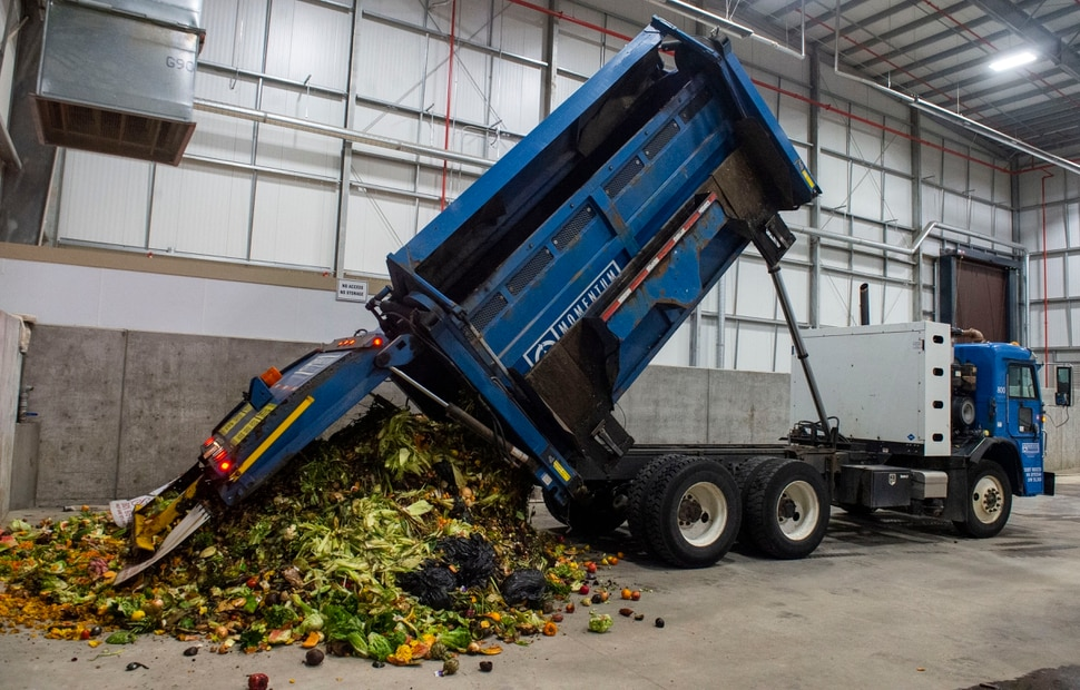 (Rick Egan | The Salt Lake Tribune) A truck from Momentum recycling dumps a load of food waste at Wasatch Resource Recovery in North Salt Lake. Friday, May 24, 2019.