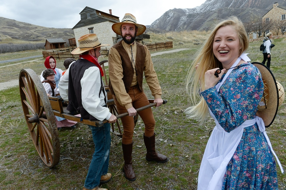 (Francisco Kjolseth | The Salt Lake Tribune) Rebecca Beach gets into the pioneer spirit along with her husband Michael, center, as they get ready to participate in a hand cart re-enactment at This Is The Place Heritage Park. In anticipation of the movie Trek: The Movie, a comedy about teens on a re-enactment trip, YouTube vloggers like the Beach family who post under the name The Beach House were invited to post about their experience.