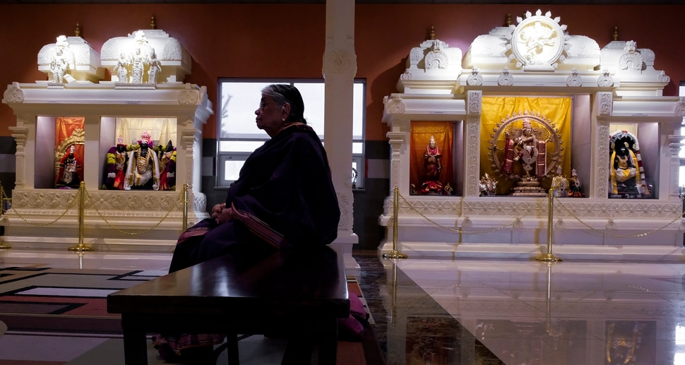 Leah Hogsten   The Salt Lake Tribune Kalyani Gopalan sits in the temple after praying Thursday, March 28, 2019. Artisans from around the world spent two years hand-carving deities in the Sri Ganesha Hindu Temple in South Jordan.