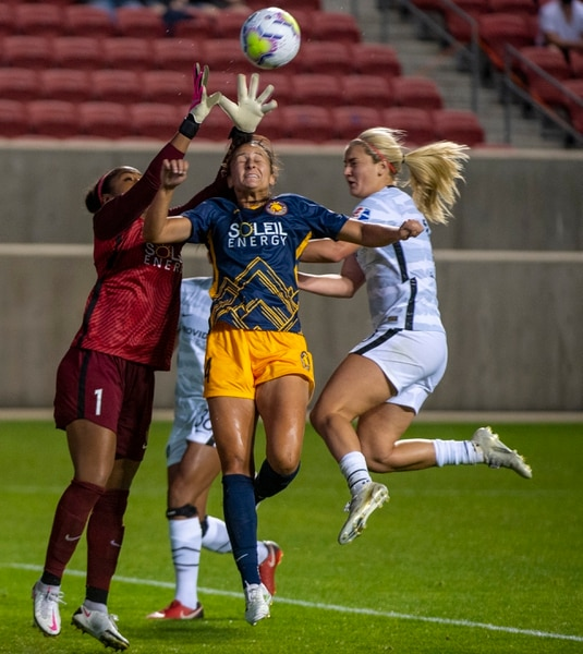(Rick Egan | The Salt Lake Tribune) Utah Royals FC goalkeeper Abby Smith (1), Utah Royals FC defender Taylor Leach (24) and Portland Thorns FC midfielder Lindsey Horan (10), collide as they go for the ball, in soccer action between Utah Royals FC and Portland Thorns FC at Rio Tinto Stadium, on Saturday, Oct. 3, 2020.