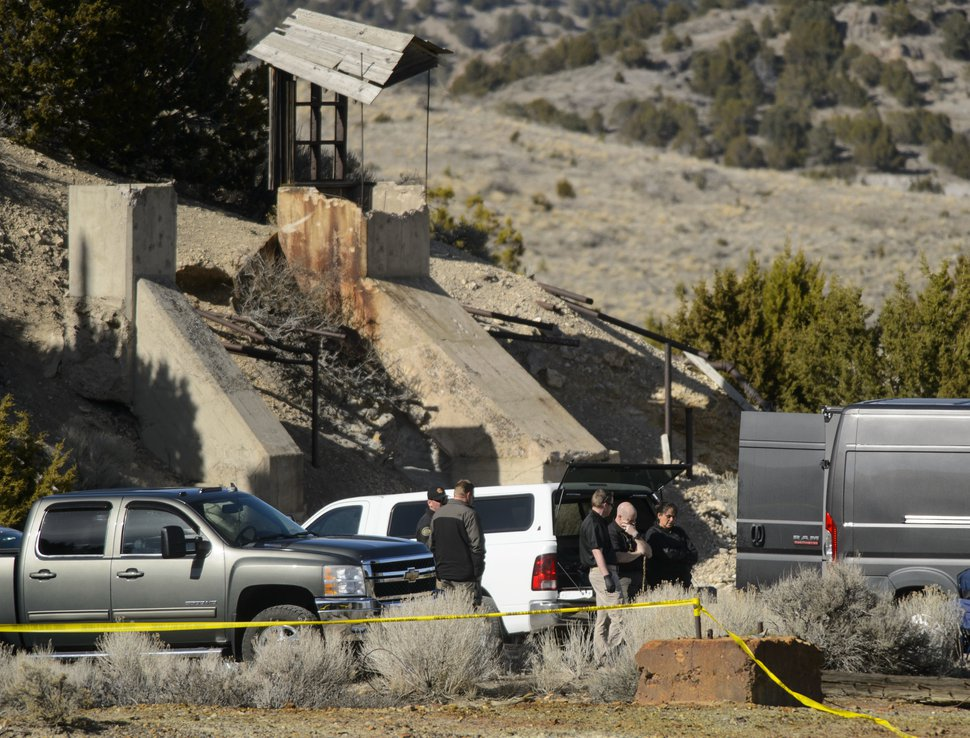 Law enforcement officials wait to load two bodies into a medical examiner's truck after they were recovered from an abandoned mine in Utah's west desert near Eureka, Wednesday, March 28, 2018. The two bodies found Wednesday in the abandoned mine are believed to be those of a teenage couple who disappeared months ago under suspicious circumstances, police said. (Steve Griffin/The Salt Lake Tribune via AP)