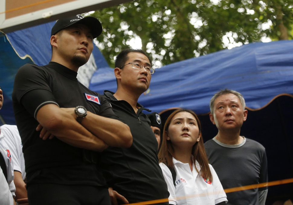 China's rescue team members join in a meeting with U.S. Special Operations Command Pacific Search and Rescue team personnel as they conduct search operation for missing 12 boys and their soccer coach, in Mae Sai, Chiang Rai province, in northern Thailand, Monday, July 2, 2018. Rescue divers are advancing in the main passageway inside the flooded cave in northern Thailand where the boys and their coach have been missing more than a week. (AP Photo/Sakchai Lalit)