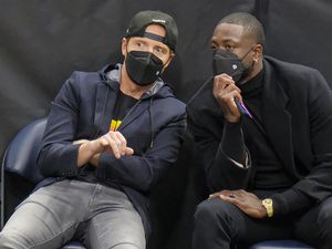 (Leah Hogsten | The Salt Lake Tribune) Utah Jazz majority owner and Qualtrics founder Ryan Smith and former Miami Heat guard and new Jazz minority owner Dwyane Wade talk as the Utah Jazz host the Indiana Pacers, Friday, April 16, 2021, at Vivint Arena.