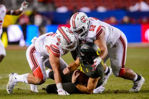 (Trent Nelson  |  The Salt Lake Tribune) Utah defensive end Bradlee Anae (6) and defensive tackle John Penisini (52), shown tackling Oregon quarterback Justin Herbert in a loss in the Pac-12 championship game, hope to leave fans with a better impression as they face Texas in the Alamo Bowl in San Antonio.
