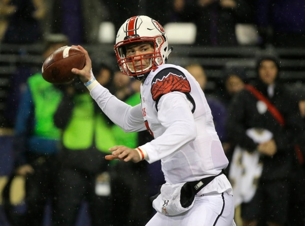 Utah quarterback Travis Wilson passes against Washington during the first half of an NCAA college football game, Saturday, Nov. 7, 2015, in Seattle. (AP Photo/Ted S. Warren)