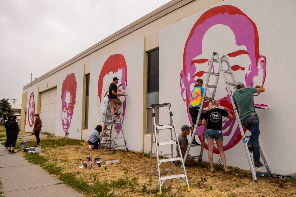 (Trent Nelson | The Salt Lake Tribune) Artists add new faces, Cody Belgard and Allen Nelson, to a series of murals depicting victims of police violence at 800 South 300 West in Salt Lake City on Sunday, June 28, 2020.